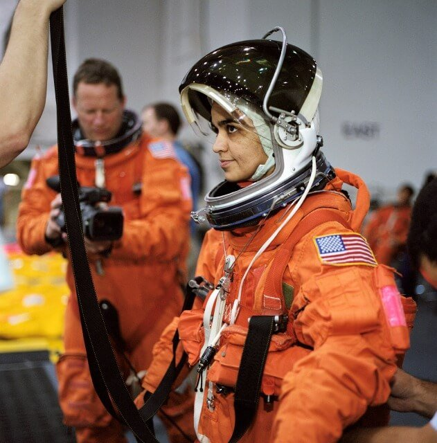 Ever Noticed How Astronauts Sometimes Wear Orange Suits ...