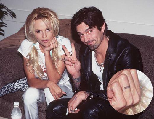 bf0e27db8377a Pamela Anderson had Tommy Lee's name tattooed on her ring finger. But after  the pair divorced in 1998, Anderson altered the tattoo to read 'Mommy'  instead.