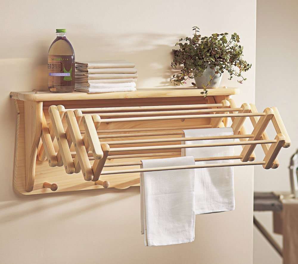 spacesaving furniture. 26. An Extendable Clothesline That Folds Right Into A Shelf Will Certainly Make Your Life Easy. Spacesaving Furniture