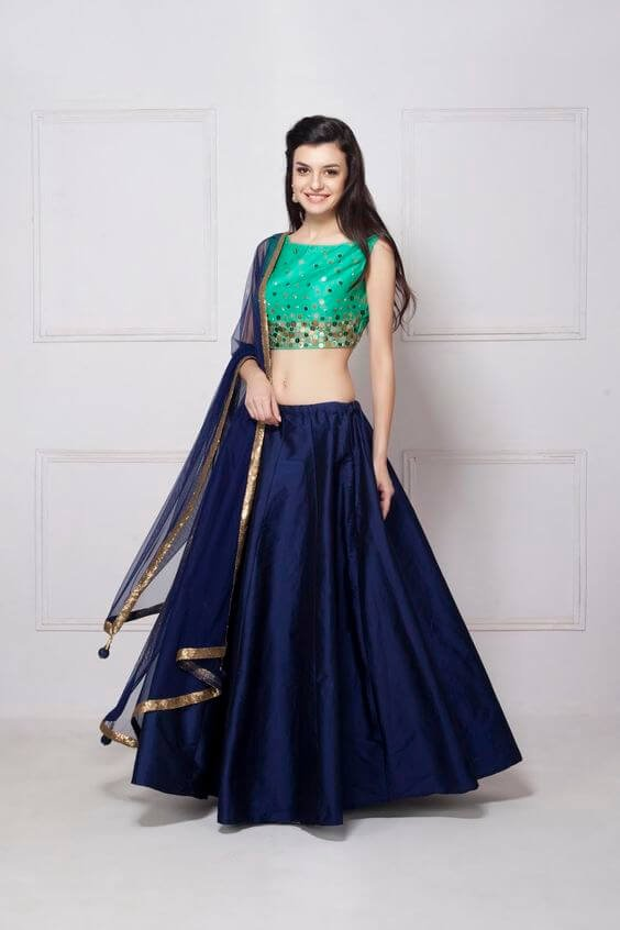 04db412b7a If you want a perfect balance of chic meets festive, you can try this royal  blue skirt with mint-green embellished choli.