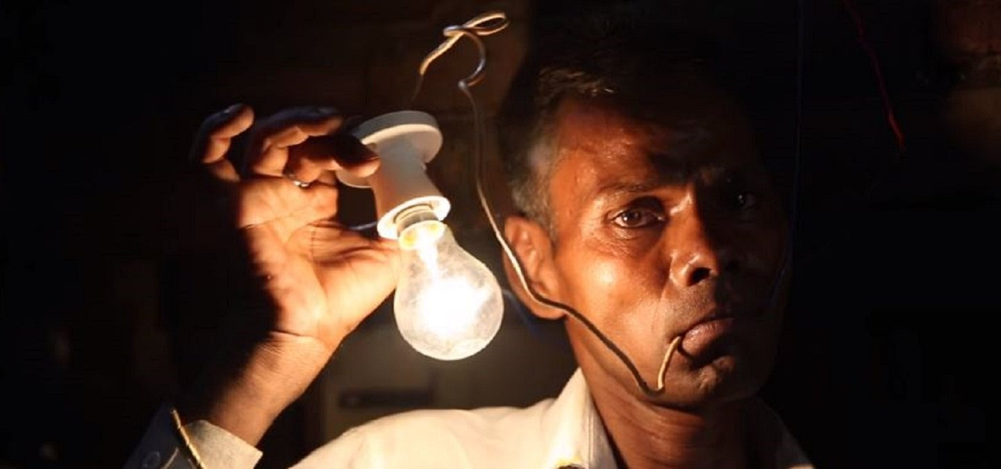 this human light bulb plugs into a live wire eats electricity