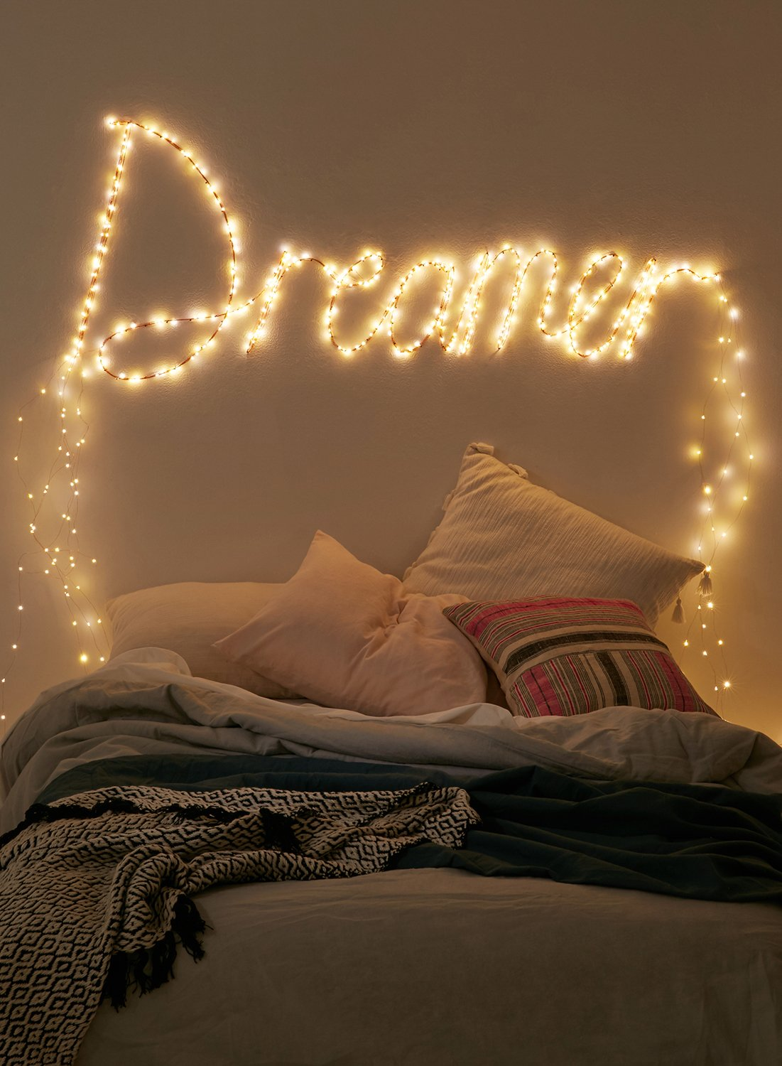 Fairy lights are always in vogue 8 ways you can use them to make your home magical for Young woman bedroom and string lights