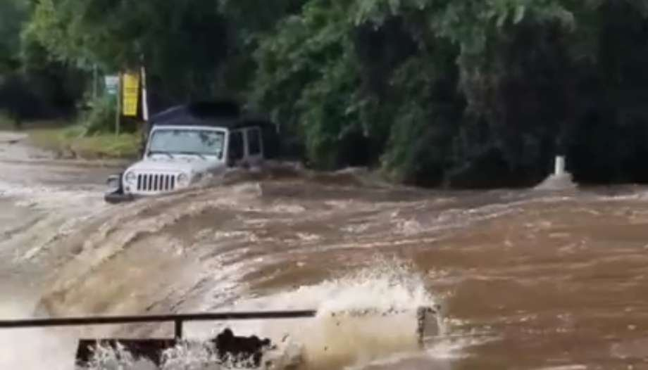 Jeep stuck in flooded river