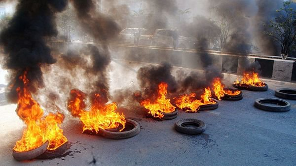 tires burned in Assam in protests against CAB